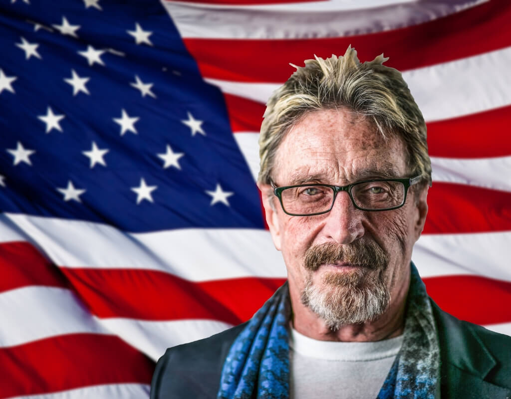 John McAfee super-imposed in front of an American flag.