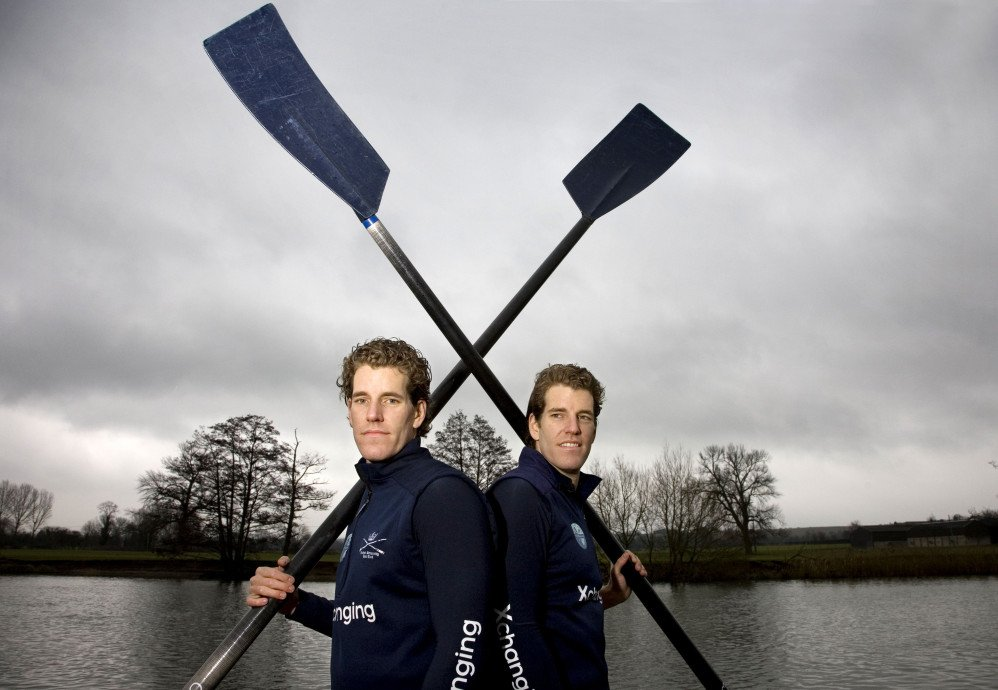 Famous Bitcoin billionaires Winklevoss twins posing with oars