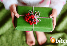 Child holding green present