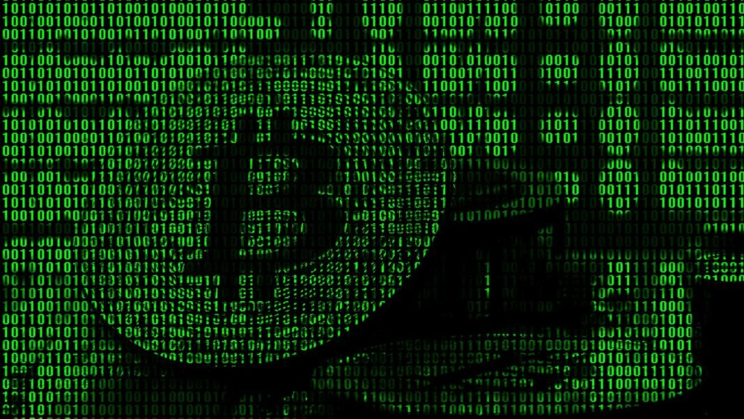 Image of the binary code from bright green digits, with the image of the physical bitcoin